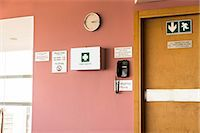 Emergency exit door with first aid kit and emergency phone Stock Photo - Premium Royalty-Freenull, Code: 6108-06908171