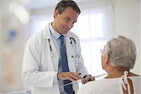 Doctor talking to older patient in hospital Stock Photo - Premium Royalty-Freenull, Code: 6113-06908234
