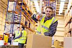 Worker taping cardboard box in warehouse Stock Photo - Premium Royalty-Free, Artist: Mark Burstyn, Code: 6113-06908404