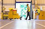 Worker carting boxes in warehouse Stock Photo - Premium Royalty-Free, Artist: Cultura RM, Code: 6113-06908429