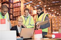 entry field - Businesswoman and workers using laptop in warehouse Stock Photo - Premium Royalty-Freenull, Code: 6113-06908436