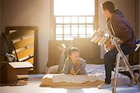 flat - Couple relaxing in attic Stock Photo - Premium Royalty-Freenull, Code: 6113-06908500