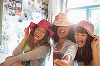 Women wearing hats in bedroom Stock Photo - Premium Royalty-Freenull, Code: 6113-06908507