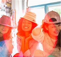 funny pose - Women wearing hats in bedroom Stock Photo - Premium Royalty-Freenull, Code: 6113-06908511
