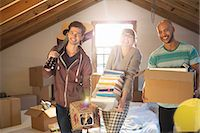 flat - Friends unpacking boxes in attic Stock Photo - Premium Royalty-Freenull, Code: 6113-06908562