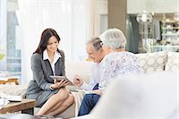 Financial advisor using tablet computer with clients Stock Photo - Premium Royalty-Freenull, Code: 6113-06908687
