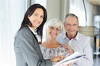 Financial advisor talking to couple indoors Stock Photo - Premium Royalty-Freenull, Code: 6113-06908759