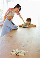 Three generations of women counting money Stock Photo - Premium Royalty-Freenull, Code: 6113-06908769