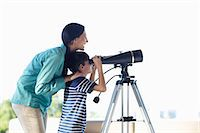preteen touch - Mother and son using telescope Stock Photo - Premium Royalty-Freenull, Code: 6113-06908788