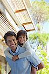 Father carrying daughter piggy back outdoors Stock Photo - Premium Royalty-Free, Artist: Beth Dixson, Code: 6113-06908837