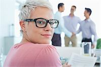 partnership - Businesswoman smiling in office Stock Photo - Premium Royalty-Freenull, Code: 6113-06908895