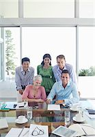 five - Business people smiling in meeting Stock Photo - Premium Royalty-Freenull, Code: 6113-06908987