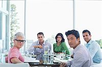 Business people sitting in meeting Stock Photo - Premium Royalty-Freenull, Code: 6113-06909027