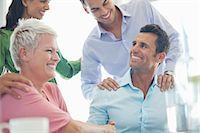 partnership - Business people laughing in meeting Stock Photo - Premium Royalty-Freenull, Code: 6113-06909038