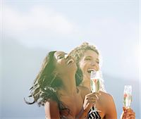 Women drinking champagne together outdoors Stock Photo - Premium Royalty-Freenull, Code: 6113-06909079