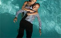 Fully dressed couple in swimming pool Stock Photo - Premium Royalty-Freenull, Code: 6113-06909187
