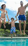 Family jumping into swimming pool Stock Photo - Premium Royalty-Freenull, Code: 6113-06909301