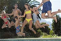 Family jumping into swimming pool Stock Photo - Premium Royalty-Freenull, Code: 6113-06909304