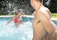 swimming pool water - Couple playing in swimming pool Stock Photo - Premium Royalty-Freenull, Code: 6113-06909312