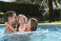 Family playing in swimming pool Stock Photo - Premium Royalty-Freenull, Code: 6113-06909320
