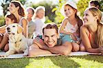 Family relaxing in backyard Stock Photo - Premium Royalty-