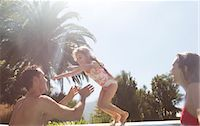 Family playing in swimming pool Stock Photo - Premium Royalty-Freenull, Code: 6113-06909382