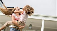 family  fun  outside - Mother and daughter playing outdoors Stock Photo - Premium Royalty-Freenull, Code: 6113-06909408