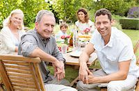 Family smiling together at table Stock Photo - Premium Royalty-Freenull, Code: 6113-06909435