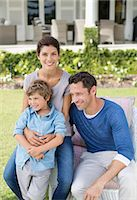 Family smiling outside house Stock Photo - Premium Royalty-Freenull, Code: 6113-06909438