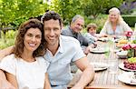 Couple smiling at table outdoors