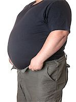 Fat man with a big belly, close-up part of the body Stock Photo - Royalty-Freenull, Code: 400-06915544