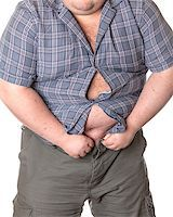 Fat man with a big belly, close-up part of the body Stock Photo - Royalty-Freenull, Code: 400-06915547