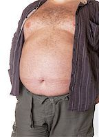 Fat man with a big belly, close-up part of the body Stock Photo - Royalty-Freenull, Code: 400-06915551