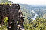 the ruins of an ancient castle stand on the hill, at the bottom of the river flows. Ukraine, Carpathians.