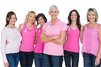 Enthusiastic women posing with pink tops for breast cancer on white background Stock Photo - Royalty-Freenull, Code: 400-06932874