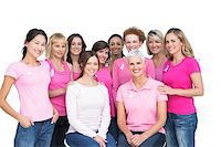 Cheerful pretty women posing and wearing pink for breast cancer on white background Stock Photo - Royalty-Freenull, Code: 400-06932886