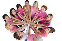 Cheerful women joined in a circle and looking up at camera wearing pink for breast cancer on white background Stock Photo - Royalty-Freenull, Code: 400-06932901
