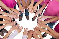 Hands joined in circle wearing pink for breast cancer on white background Stock Photo - Royalty-Freenull, Code: 400-06932902