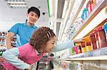 Little Girl Reaching for Food in Supermarket