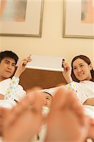 Family Using Tablet in Bed Stock Photo - Premium Royalty-Freenull, Code: 6116-06938711