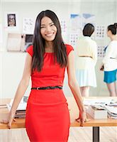 Smiling Businesswoman in Creative Office Stock Photo - Premium Royalty-Freenull, Code: 6116-06938858
