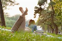 Teenage girl reading book in the park Stock Photo - Premium Royalty-Freenull, Code: 6116-06939111