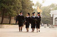 Young Graduates Walking Across Campus Stock Photo - Premium Royalty-Freenull, Code: 6116-06939206