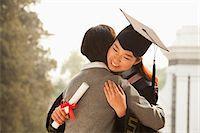 Mother and Graduate Hug Stock Photo - Premium Royalty-Freenull, Code: 6116-06939209