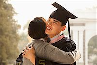 Mother and Graduate Hug Stock Photo - Premium Royalty-Freenull, Code: 6116-06939210