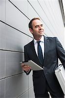 Portrait of Businessman using Tablet Computer, Mannheim, Baden-Wurttemberg, Germany Stock Photo - Premium Royalty-Freenull, Code: 600-06939769