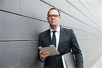 Portrait of Businessman using Tablet Computer Outdoors, Mannheim, Baden-Wurttemberg, Germany Stock Photo - Premium Royalty-Freenull, Code: 600-06939771