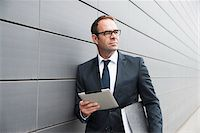 Portrait of Businessman using Tablet Computer Outdoors, Mannheim, Baden-Wurttemberg, Germany Stock Photo - Premium Royalty-Freenull, Code: 600-06939772