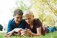 Boys using Cell Phone Outdoors, Mannheim, Baden-Wurttemberg, Germany Stock Photo - Premium Royalty-Freenull, Code: 600-06939775