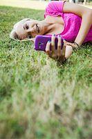 Teenage Girl using Cell Phone Outdoors, Mannheim, Baden-Wurttemberg, Germany Stock Photo - Premium Royalty-Freenull, Code: 600-06939777